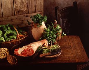 Raw Leg of lamb, new potatoes, asparagus, spinach, carrots, parsley and mintの写真素材 [FYI03545374]