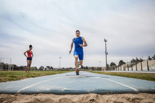 Young male long jumper sprint training at sport facilityの写真素材 [FYI03546752]