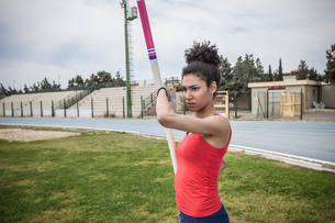 Young female pole vaulter concentrating at sport facilityの写真素材 [FYI03546755]