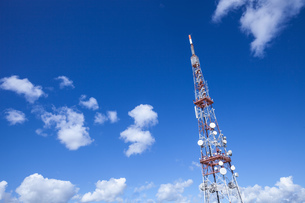 Low angle view of communication tower against blue skyの写真素材 [FYI03546776]