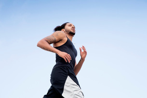 Man with tattoo joggingの写真素材 [FYI03547217]
