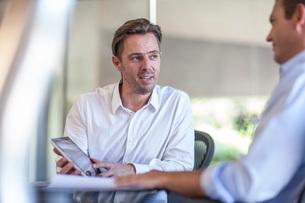 Male designer explaining idea on digital tablet at design officeの写真素材 [FYI03547519]
