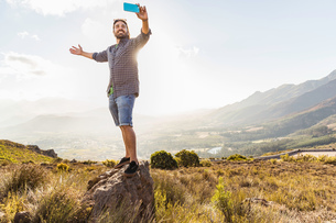 Man taking selfie on sunny day, Franschhoek, South Africaの写真素材 [FYI03549083]