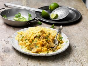 Food, vegetarian meals, paneer and cauliflower korma with pilau rice, green chilli, fresh lime, coriの写真素材 [FYI03549415]