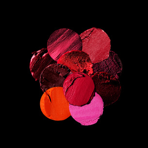 Variety of circular lipstick slices against black backgroundの写真素材 [FYI03550876]