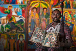 Priest showing an ancient religious book in an Orthodox Monastery, Tigray, Ethiopiaの写真素材 [FYI03552973]