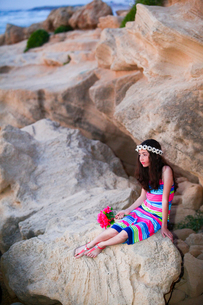 Girl resting on rocksの写真素材 [FYI03554051]