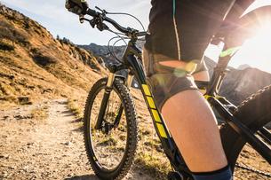 Cyclist on mountain biking area, Kleinwalsertal, trails below Walser Hammerspitze, Austriaの写真素材 [FYI03554086]