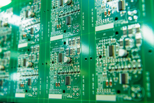 Detail of circuit boards in circuit board assembly factory, close upの写真素材 [FYI03554388]