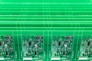 Detail of circuit boards in circuit board assembly factory, close upの写真素材 [FYI03554391]