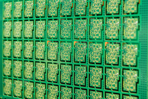 Detail of circuit boards in circuit board assembly factory, close upの写真素材 [FYI03554392]