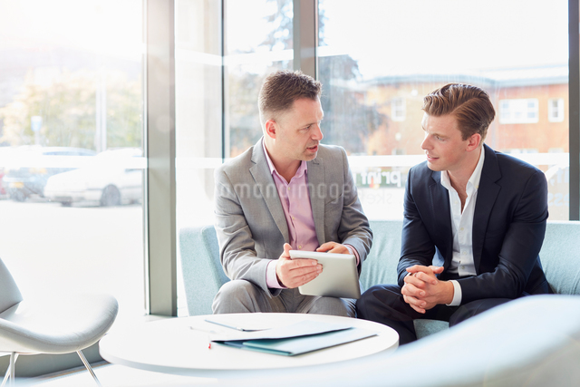 Two  businessmen using digital table at office meetingの写真素材 [FYI03555445]
