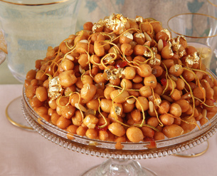 Traditional Italian party food, Cicerchiata, chick peas with gold leafの写真素材 [FYI03555741]