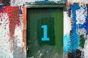 Number 1 door and paint covered wall in ship painters yardの写真素材 [FYI03557141]