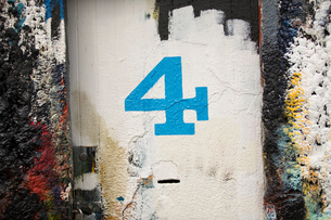 Number 4 door and paint covered wall in ship painters yardの写真素材 [FYI03557144]
