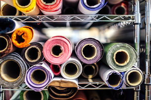 Close-up of rolls of cloth in book arts workshopの写真素材 [FYI03557558]
