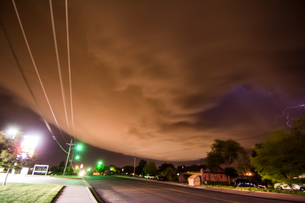 A supercell storm cloud sparking with lightning sweeping over Amarillo, Texasの写真素材 [FYI03557828]