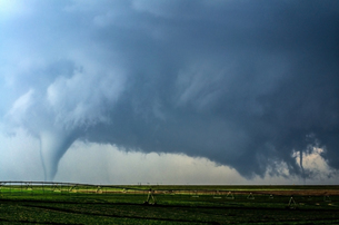 A supercell thunderstorm produces two tornadoes at once in a farm field south of Dodge City, Kansasの写真素材 [FYI03557843]