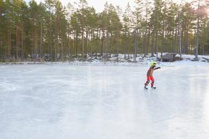 Boy ice skating on frozen lake, Gavle, Swedenの写真素材 [FYI03558143]