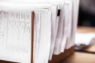 Close up of ordered paperwork in office desk rackの写真素材 [FYI03558180]
