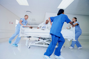 Doctor and medical running with patient bed in hospital emergencyの写真素材 [FYI03558265]
