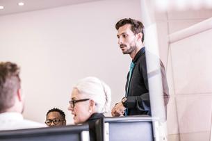 Businessman making presentation to team in board meetingの写真素材 [FYI03559083]