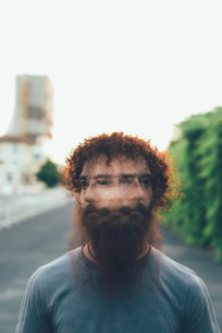 Multiple exposure portrait of young male hipster shaking headの写真素材 [FYI03559260]