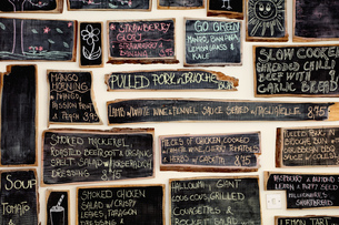 Quirky coffee shop interior with menu on chalked blackboardsの写真素材 [FYI03560754]