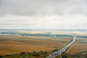 Highway through rural landscape, Clermont Ferrand, Franceの写真素材 [FYI03561310]