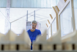 Carpenter making moulds in architectural stone factoryの写真素材 [FYI03561790]