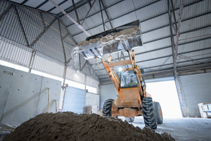 Digger with sand in architectural stone factoryの写真素材 [FYI03561809]