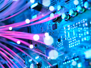 Cyber attack with fibre optics shooting past electronics of broadband hubの写真素材 [FYI03561881]