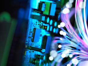 Cyber attack with fibre optics shooting past electronics of broadband hubの写真素材 [FYI03561883]