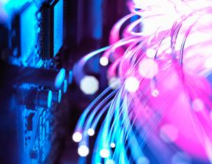 Cyber attack with fibre optics shooting past electronics of broadband hubの写真素材 [FYI03561884]