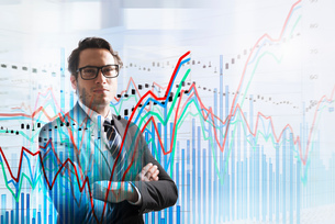 Conceptual image of businessman with graph dataの写真素材 [FYI03561985]