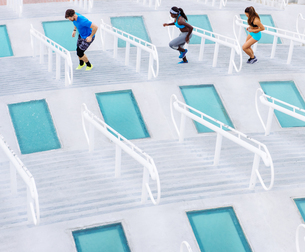 Man and two women training, stepping sideways on stairway at sport facility, downtown San Diego, Calの写真素材 [FYI03562503]