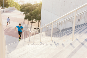 Man training, running up stairway at sport facility, downtown San Diego, California, USAの写真素材 [FYI03562504]