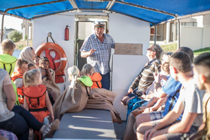 Captain talking to tourists on boat trip, Cape Town, South Africaの写真素材 [FYI03562536]