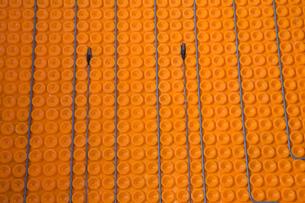 Close up of underfloor heating elementsの写真素材 [FYI03563467]