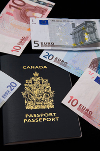 Canadian passport and euros on black backgroundの写真素材 [FYI03563469]