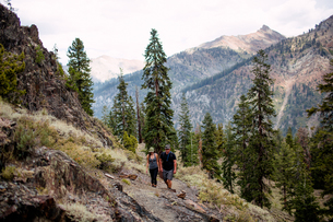 Mid adult couple hiking along pathway, Mineral King, Sequoia National Park, California, USAの写真素材 [FYI03564466]