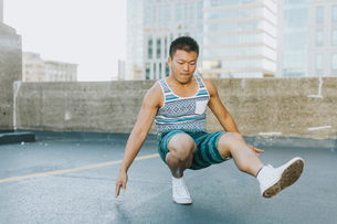 Man breakdancing on concrete floor, Boston, Massachusetts, USAの写真素材 [FYI03564743]