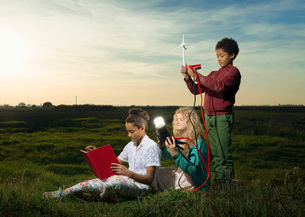 Children using miniature wind turbine to power light bulb, Breda, Netherlandsの写真素材 [FYI03565958]