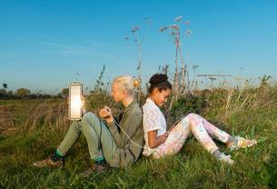 Children using miniature solar cell to power digital tablet, Breda, Netherlandsの写真素材 [FYI03565959]