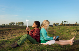 Children using miniature wind turbine to power digital tablet, Breda, Netherlandsの写真素材 [FYI03565960]