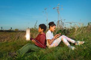 Children using miniature solar cell to power digital tablet, Breda, Netherlandsの写真素材 [FYI03565961]