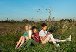 Children using miniature solar cell to power digital tablet, Breda, Netherlandsの写真素材 [FYI03565963]