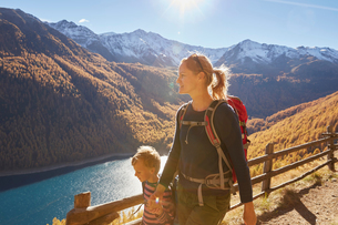 Mother and son hiking along pathway, Schnalstal, South Tyrol, Italyの写真素材 [FYI03566049]
