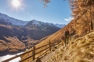 Mother and son hiking along pathway, Schnalstal, South Tyrol, Italyの写真素材 [FYI03566050]