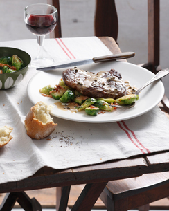 Steak with green pepper sauce, brussels sprouts and baconの写真素材 [FYI03566199]